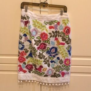 Anthropology embroidered skirt with pom pom detail